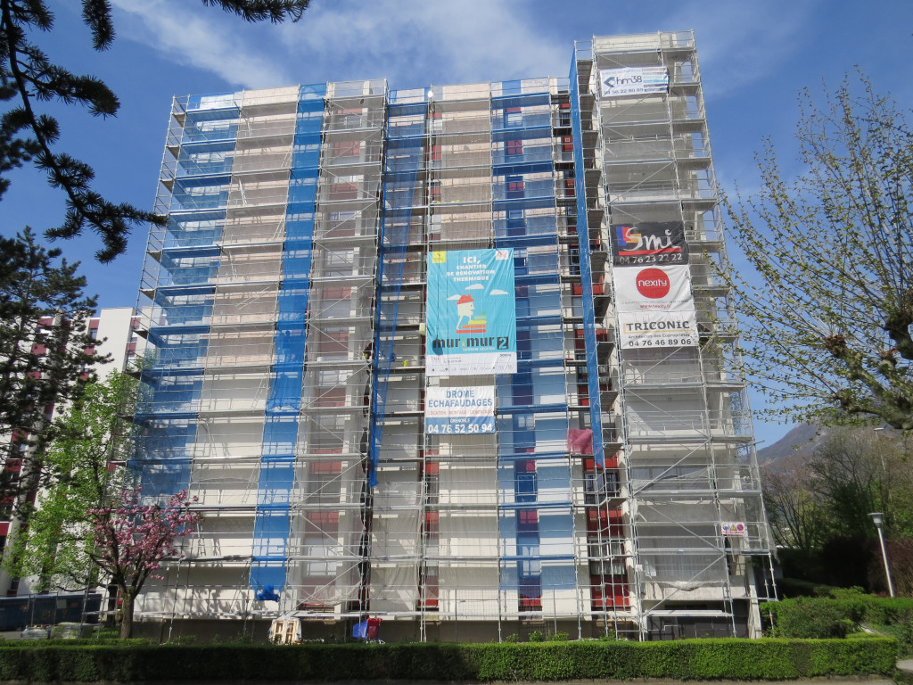 A tower block undergoing renovation in Grenoble.