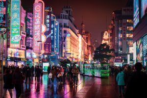 Chinese street-scape with people and tram